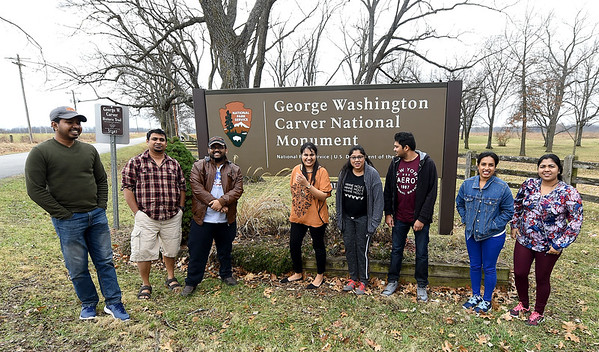 A group of Oklahoma State University chemistry and engineering students pose for a photo outside the locked gates of George Washington Carver National Monument on Wednesday. The students had hoped to tour Carver on their way to Branson, but were locked out because of the shutdown.<br /> Globe | Laurie Sisk