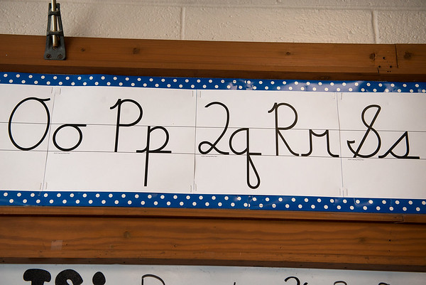 Examples of cursive letters are hung above the board in third grade at Kelsey Norman Elementary.<br /> Globe | Roger Nomer