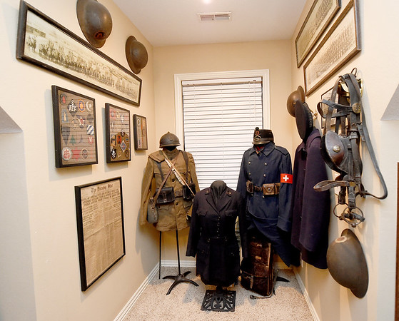 Numerous World War I items line the walls in a room at World War I collector Shannon Kelly's home. Kelly's grandfather, James Greg Kelly, served in WWI.<br /> Globe   Laurie Sisk