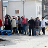 Guests wait outside for the start of the Salvation Army Christmas dinner on Tuesday.<br /> Globe | Laurie Sisk