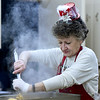 Volunteer Denise Winans mixes fresh dressing during First Christian Church's community Christmas dinner on Tuesday at the church.<br /> Globe | Laurie SIsk