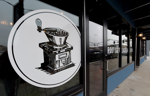 The Root Coffehouse and Creperie in Pittsburg stands as one of the first businesses open as part of the Block 22 project.<br /> Globe | Laurie Sisk