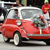 A tiny car makes its way down Military Avenue during the Baxter Springs Christmas Parade on Saturday in downtown Baxter Springs.<br /> Globe | Laurie Sisk