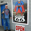 SuperTam on 66 owner Larry Tamminen stands outside his ice cream store and Superman museum on Tuesday afternoon. The store is a popular stop for tourists traveling on historic Route 66.<br /> Globe | Laurie Sisk