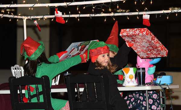 Elves ready presents for delivery atop the Talent Force Worksop float during the 2018 Christmas Parade on Tuesday night in Downtown Joplin.<br /> Globe | Laurie Sisk
