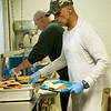Samuel Shannon, front, helps Chef Rusty Long plate lunch on Wednesday at the Salvation Army. Funds from the annual kettle drive help feed about 200 people a day at the Salvation Army.<br /> Globe | Laurie Sisk