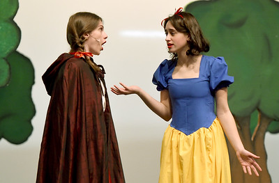 From the left: Chloe Browe (Little Red Riding Hood) and Isabella Sotlar (Snow White) rehearse their roles for Joplin High School's annual Christmas children's show on Tuesday night at JHS. Globe | Laurie Sisk