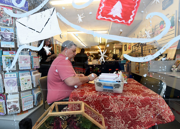 Noel Postmaster Don Spiares on Thursday stamps cards sent to the Noel Post Office before they reach their final destinations.<br /> Globe   Laurie SIsk