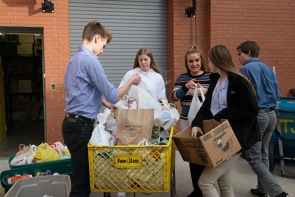 Thomas Jefferson Independent Day School students load food donations for the Salvation Army on Tuesday.<br /> Globe | Roger Nomer