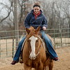 Sami Bayless rides her horse Dunny on Wednesday in Lamar. One of Bayless' goals since her accident has been to become strong enough to ride her horse again.<br /> Globe | Roger Nomer