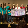 (from left) Richard, Vera, Jessica, Richie, Jenna, and Juliana Joseph present a check for $1,560 to Paula Baker, Freeman Health System president and CEO, Vicky Mieseler, chief administrative officer with Ozark Center, Wendy Jones, operations manager at Turnaround Ranch and Melissa Moore, director of pediatric services at Freeman Health System on Friday at Turnaround Ranch. The Joseph family is responsible for the Lights of Hope project, with gathered proceeds going to area organizations like Turnaround Ranch.<br /> Globe | Roger Nomer