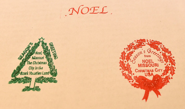 Stamps, including an original from 1938 (left) are still used by the Noel Post Office, where cards are received from all over the world to be stamped and then sent to their final destinations.<br /> Globe | Laurie Sisk