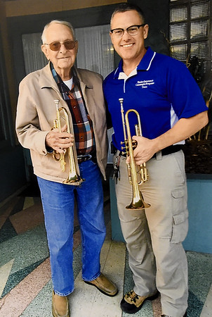 """Bruce Benson is shown is this contributed photograph with his friend and musician Dave Bergland, a Marine veteran who has joined Benson in playing """"Taps"""" across from the Webb City Post Office.<br /> Courtesy Photo"""