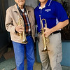 "Bruce Benson is shown is this contributed photograph with his friend and musician Dave Bergland, a Marine veteran who has joined Benson in playing ""Taps"" across from the Webb City Post Office.<br /> Courtesy Photo"