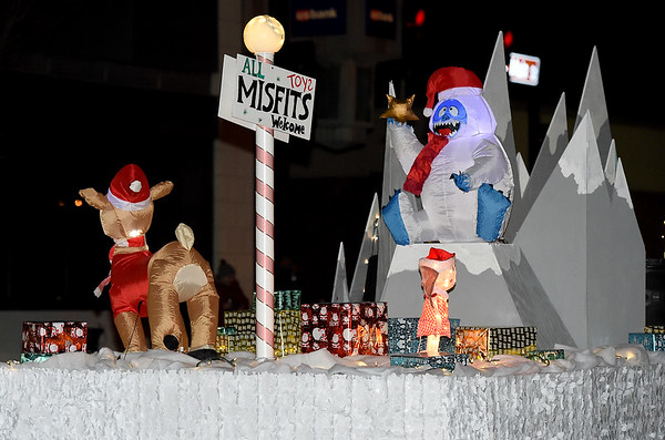 """Inflatable characters reenact the children's favorite, """"Rudolph the Red Nosed Reindeer"""" during the 2018 Christmas Parade on Tuesday night in Downtown Joplin.<br /> Globe 