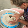 Suzi Huntington, owner of Crackpot Pottery & Art Studio, works on a clay creation on Wednesday at the studio.<br /> Globe   Roger Nomer