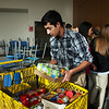 Humza Rehman, Thomas Jefferson Independent Day School junior, loads donations for the Salvation Army on Tuesday.<br /> Globe | Roger Nomer