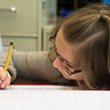 Brea Timberlake works on a cursive writing assignment in third grade at Kelsey Norman Elementary on Thursday.<br /> Globe | Roger Nomer