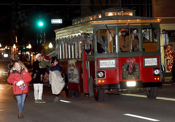 Webb City's Old Urban Trolley makes its way down the parade route during the 2018 Christmas Parade on Tuesday night in Downtown Joplin.<br /> Globe | Laurie Sisk