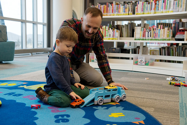 Zach and Ben, 3, Gibson play with cars on Monday at the Joplin Public Library.<br /> Globe | Roger Nomer