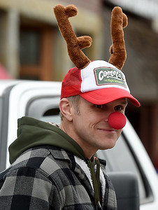 Arthur Commons, of Baxter Springs, displays his Christmas spirit as he watches the Baxter Springs Christmas Parade on Saturday in downtown Baxter Springs. Globe | Laurie Sisk