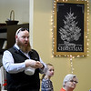 Jeremy Ritchie gives away door prizes donated by area businesses during the Carl Junction Community Christmas Dinner on Tuesday at the Carl Junction Community Center.<br /> Globe | Laurie Sisk