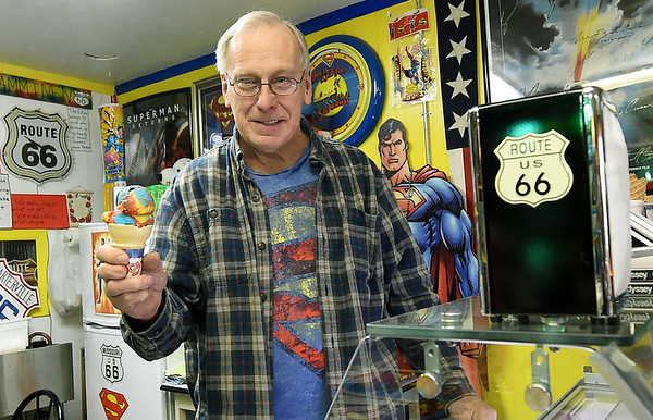 SuperTam on 66 owner Larry Tamminen holds his popular Superman ice cream inside his ice cream store and Superman museum on Tuesday afternoon. The store is a popular stop for tourists traveling on historic Route 66.<br /> Globe | Laurie Sisk