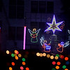 A choir of angels lights up the night sky during the Way of Salvation Christmas light display on Wednesday night at the Congregation of the Mother of the Redeemer in Carthage.<br /> Globe   Laurie Sisk