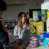 Thomas Jefferson Independent Day School seniors Matthew Palmer and Shannon Tewari load food donations for the Salvation Army on Tuesday.<br /> Globe | Roger Nomer