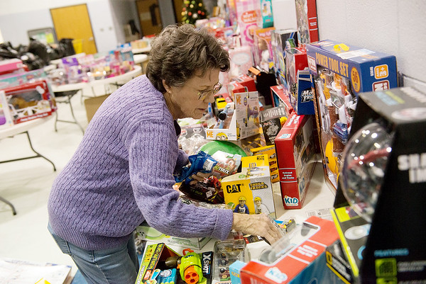 Sharon Boyd volunteers at the Joplin Salvation Army on Tuesday.<br /> Globe | Roger Nomer