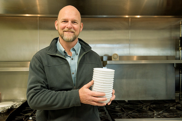 James Whitford, co-founder and executive director of Watered Gardens, is pictured in the kitchen on Watered Gardens on Tuesday.<br /> Globe | Roger Nomer
