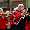 Members of the Baxter Springs Lion Pride Band make their way down Military Avenue during the Baxter Springs Christmas Parade on Saturday in downtown Baxter Springs.<br /> Globe | Laurie Sisk