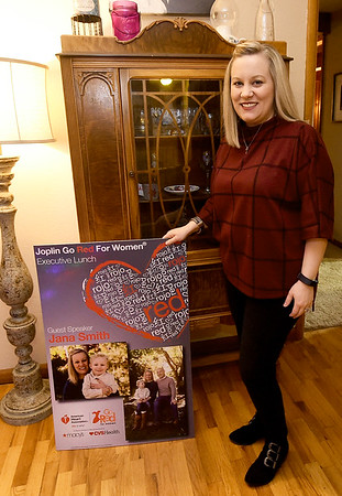 Heart patient Jana Smith poses with a poster of some of her prior work with the American Heart Association. Smith is helping kick off the AHA's new statewide campaign.<br /> Globe   Laurie Sisk