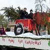 4-Hers from Glittering Stones 4-H Club make their way down Main Street during the Galena Christmas Parade on Saturday in downtown Galena.<br /> Globe | Laurie Sisk