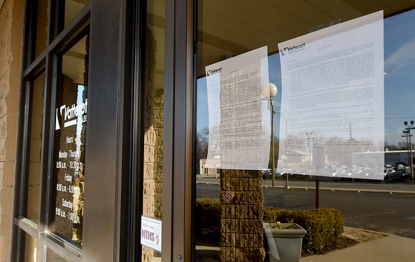 A notice to employees of Vatterott College hangs on the door of the college on Tuesday.<br /> Globe | Laurie Sisk