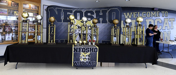 Large trophies that await the winners in each division grace the lobby of Neosho High School during the 2018 Neosho Holiday Classic on Thursday afternoon at NHS. <br /> Globe   Laurie Sisk