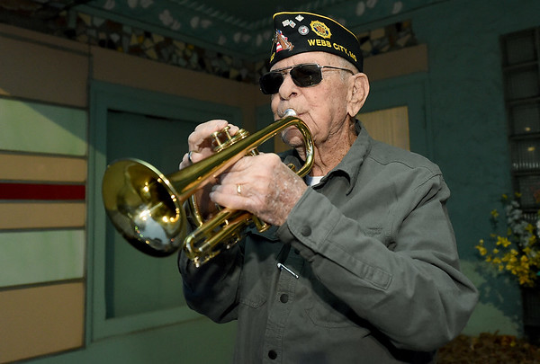 """Veteran Bruce Benson plays """"Taps"""" at sunset across from the Webb City Post Office on Wednesday.<br /> Globe   Laurie Sisk"""