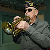 "Veteran Bruce Benson plays ""Taps"" at sunset across from the Webb City Post Office on Wednesday.<br /> Globe 