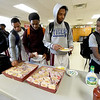 Players from Craigmont High School in Memphis, Tenn. refuel in one of four hospitality rooms during the 2018 Neosho Holiday Classic on Thursday afternoon at NHS. More than 40 volunteers help feed players, coaches, media and officials after each game in the tournament.<br /> Globe | Laurie Sisk