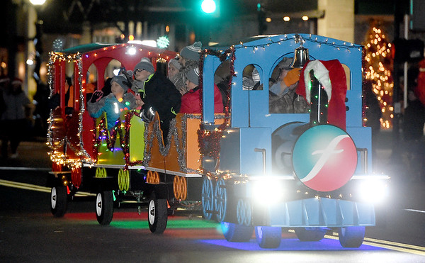 A tiny train, complete with a caboose, makes its way down the parade route, courtesy of Freeman Health Systems, during the 2018 Christmas Parade on Tuesday night in Downtown Joplin.<br /> Globe | Laurie Sisk