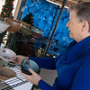 Eileen Nichols arranges bowls on Wednesday that will be for sale at the Webb City Farmers Market.<br /> Globe | Roger Nomer