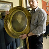 World War I collector Shannon Kelly holds a portrait of his grandfather, James Greg Kelly, who served in WWI.<br /> Globe | Laurie Sisk