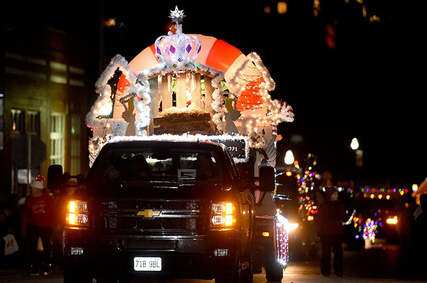 Colorful floats light up the night during the Neosho Christmas Parade on Saturday night in downtown Neosho.<br /> Globe | Laurie Sisk