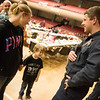 Dakota Triplett, Joplin Fire Department firefighter, talks with Sarah Myers and her son Landon Berg, 5, on Tuesday at the annual Christmas for Kids event at Joplin Memorial Hall.<br /> Globe | Roger Nomer