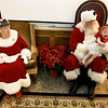 One-year-old Addison Jones expresses more than a little intrepisation as she makes her first visit with Santa during the City of Pittsburg's Christmas celebration on Thursday at Pittsburg City Hall. In addition to visits with Santa, chikdren were given small gifts and candy canes.<br /> Globe | Laurie Sisk