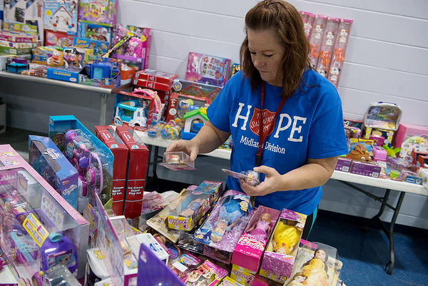 Debra Gaskill, Angel Tree coordinator, sorts gifts at the Joplin Salvation Army on Tuesday.<br /> Globe | Roger Nomer