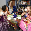 From the left: Donned in pretty dresses, Maddison Grizzel, 4, Melayha Wiese, 9, Mariah Grizzel, 6, Jazzmyn Schoof, 10 and Tinslee Wiese, 2,  enjoy refreshments and conversation at the Granny's Touch Tea Party on Saturday at Granny's Touch in Carl Junction.<br /> Globe | Laurie Sisk