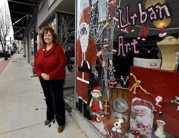 Urban Art gallery owner Linda Teeter stands outside her downtown gallery on Thursday. Teeter is lobbying for an arts district in Joplin.<br /> Globe | Laurie Sisk
