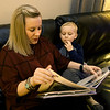 Heart patient Jana Smith looks through a family photo album with her son, Charlie Smith, 5, in their Carthage home on Wednesday night. Smith is helping kick off the American Heart Association's new statewide campaign.<br /> Globe | Laurie Sisk