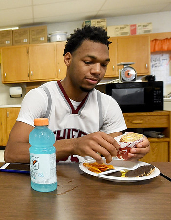 Jordan Johnson, of Memphis' Craigmont High School refuels in one of four hospitality rooms after a morning game with Lamar during the 2018 Neosho Holiday Classic on Thursday at NHS. More than 40 volunteers help feed players, coaches, media and officials after each game in the tournament.<br /> Globe | Laurie Sisk